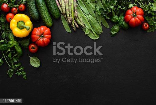istock Dark culinary background with fresh produce 1147561451
