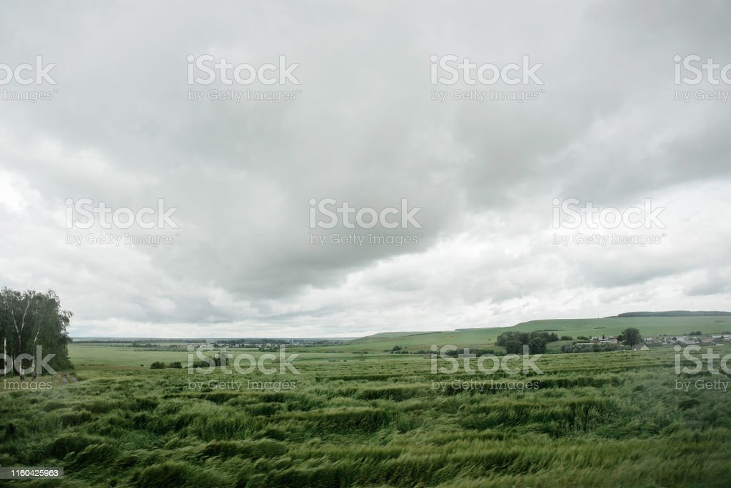 bad weather in summer day, dark dramatic rainy sky clouds over...