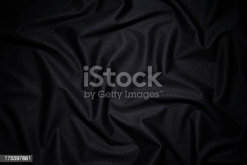 Dark fabric texture background with wave pattern.