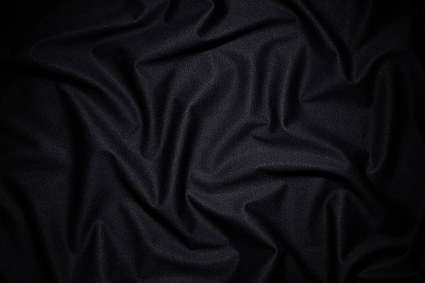 Dark fabric texture background with wave pattern stock photo