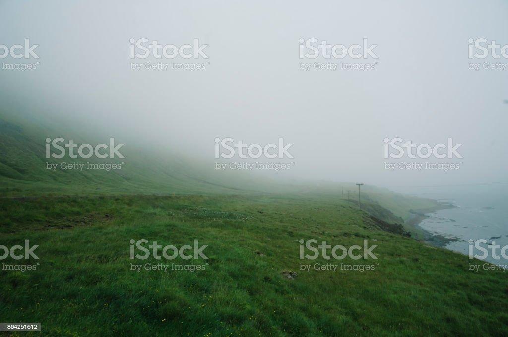 dark foggy rocky ocean beach cliff royalty-free stock photo