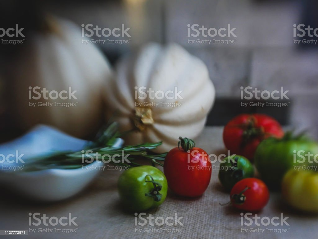 Dark food image of tomatoes and vegetables