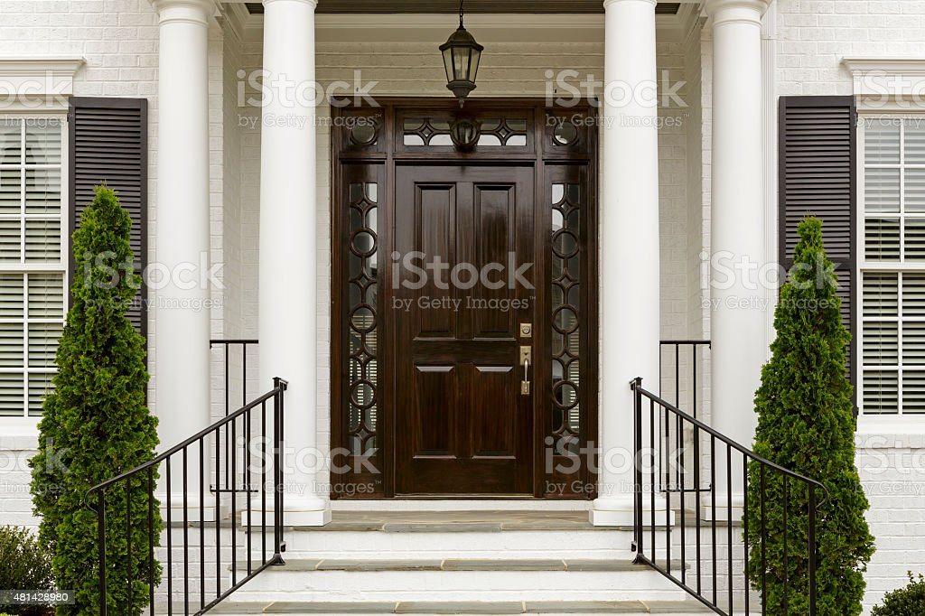 Dark front door with white columns stock photo