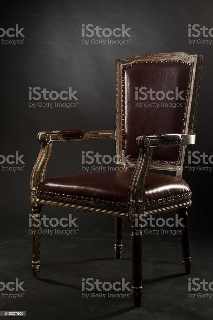 Dark genuine leather vintage chair stock photo