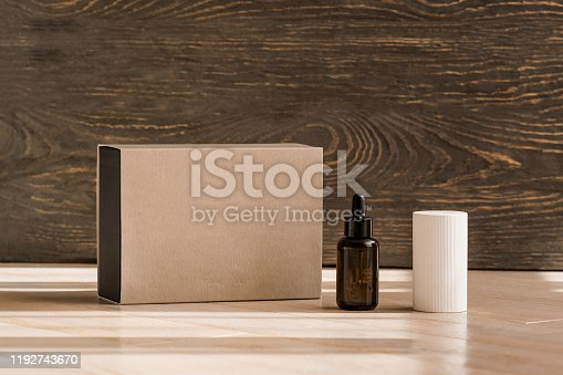 Dark amber glass drop bottle, scented block and craft paper box. Home fragrant, ceramic aromatic diffuser, aroma therapy. Mock up, cosmetic brand packaging, copy space, minimalism concept