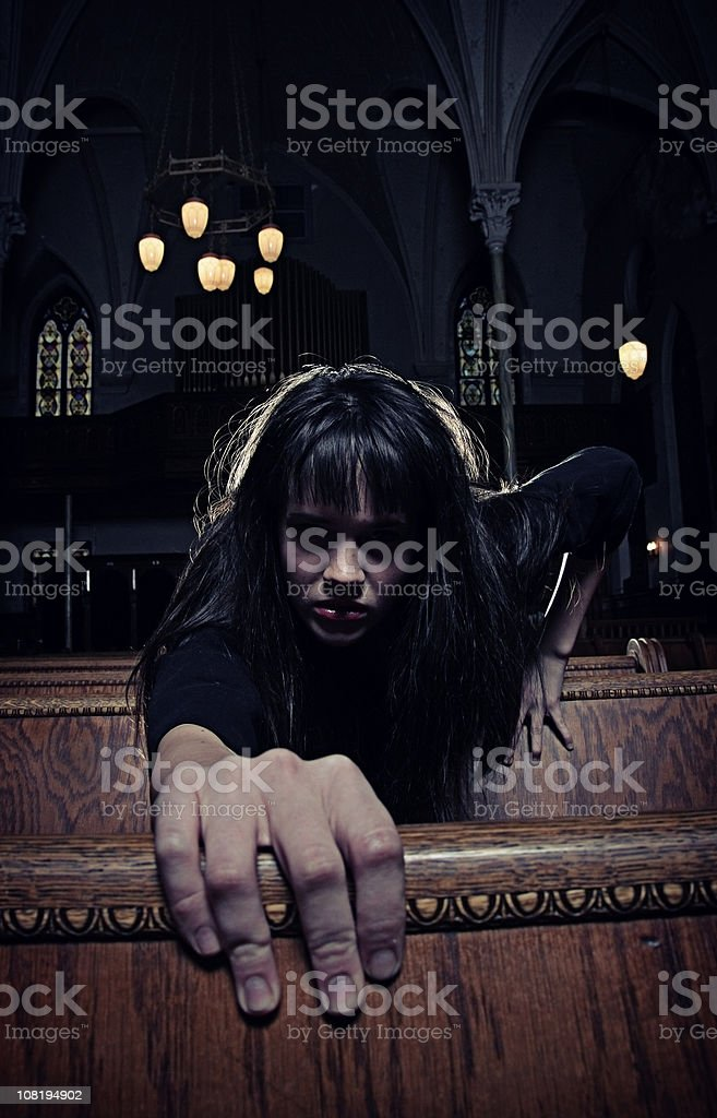 Dark Gothic Woman in Old Spooky Cathedral royalty-free stock photo