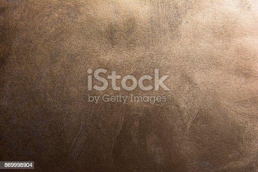 istock Dark gradient bronze texture background 869998904