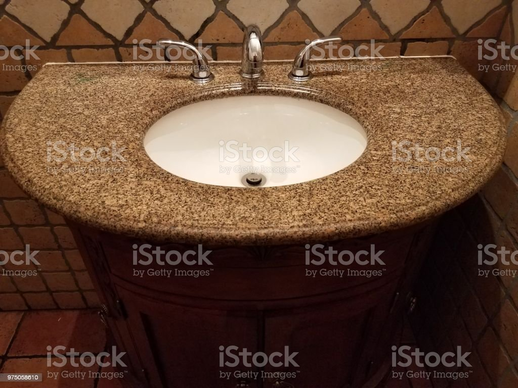 dark granite bathroom sink with cabinet stock photo