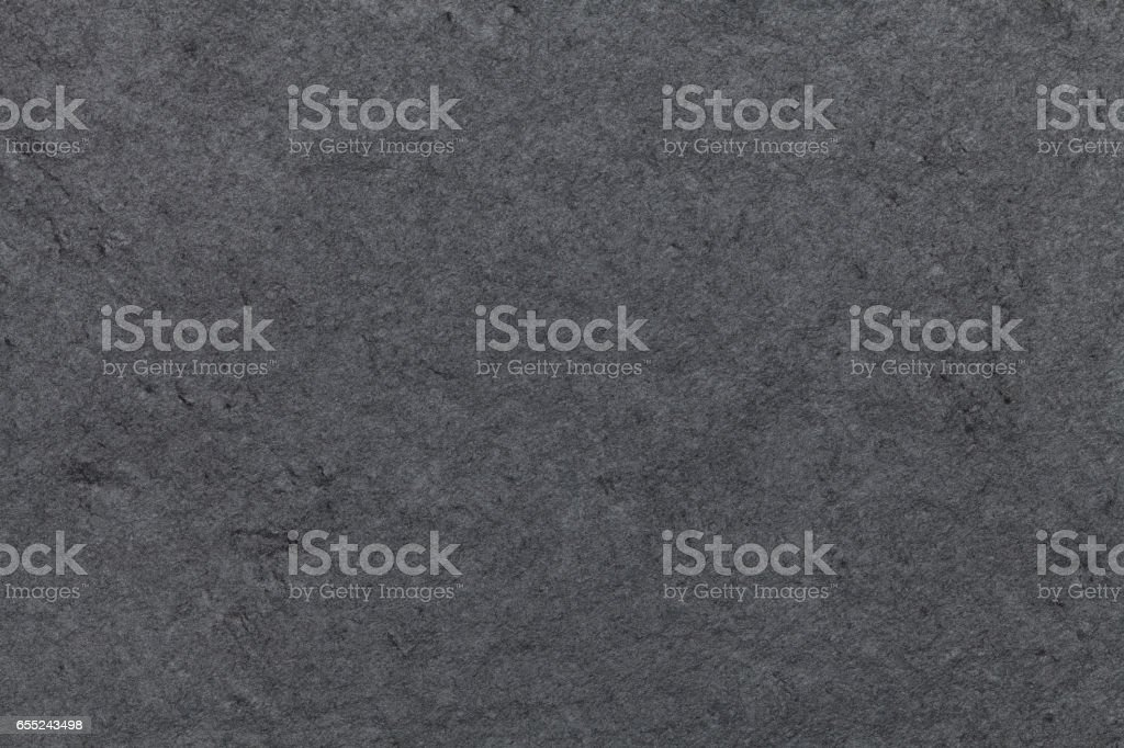 Dark gray background of natural slate. Texture black stone closeup. stock photo