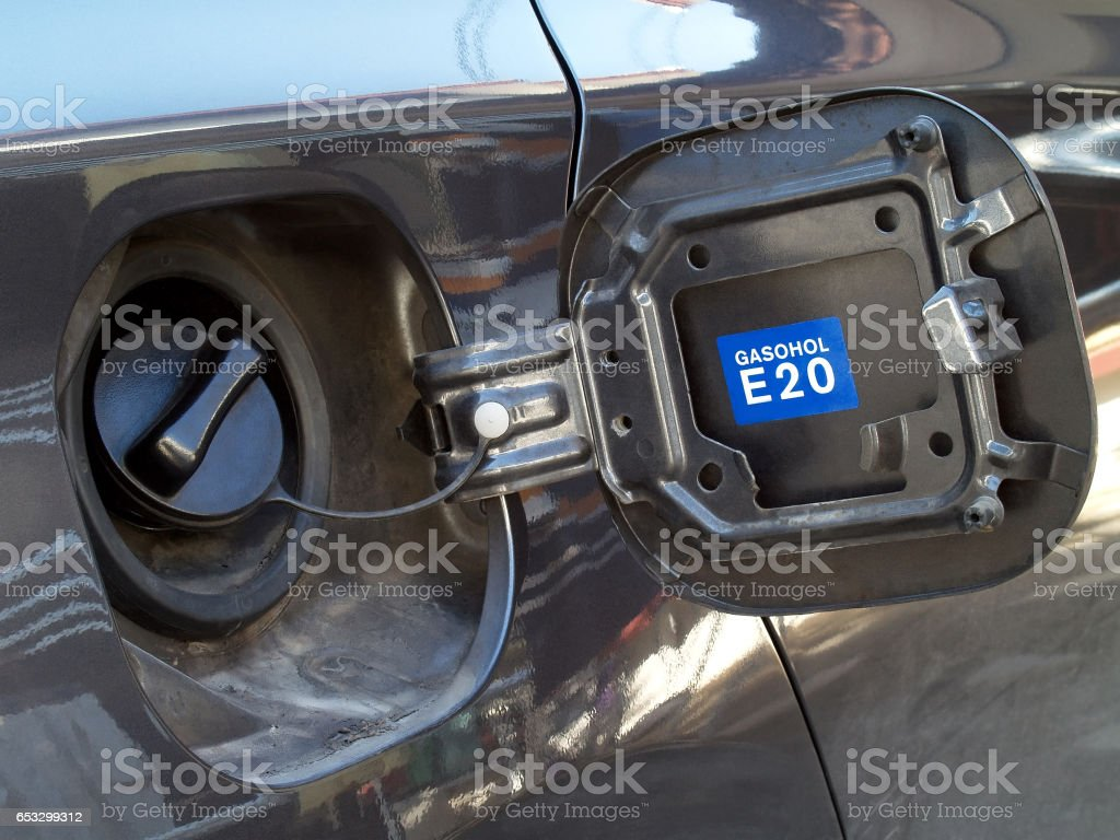 dark gray car fuel tank cap cover with blue label inside for Identify type of fuel stock photo