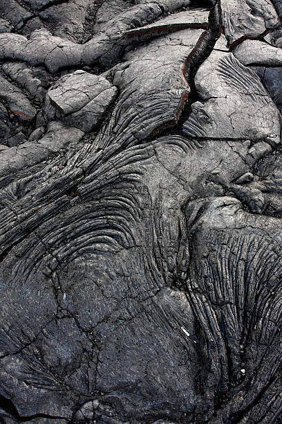 Dark gray rock formation formed by lava stock photo