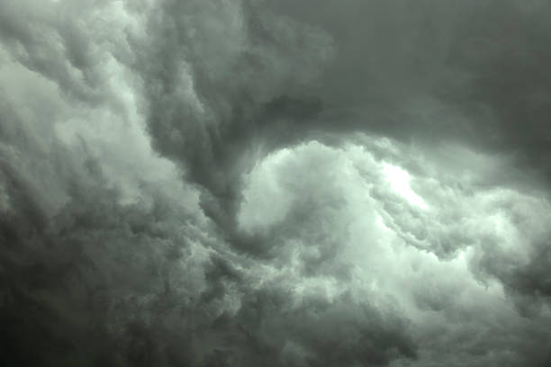 Dark gray swirling storm clouds stock photo