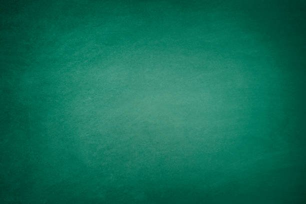 Dark Green Blackboard Blank green chalkboard background with traces of erased chalk green color stock pictures, royalty-free photos & images
