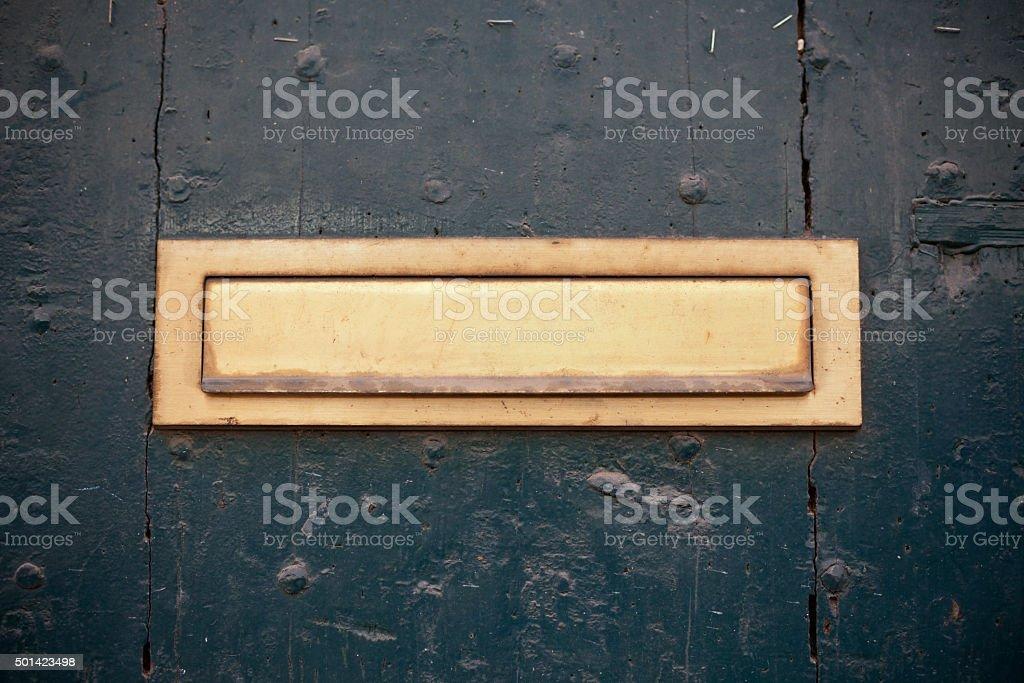 Dark green door with letter slot mailbox stock photo