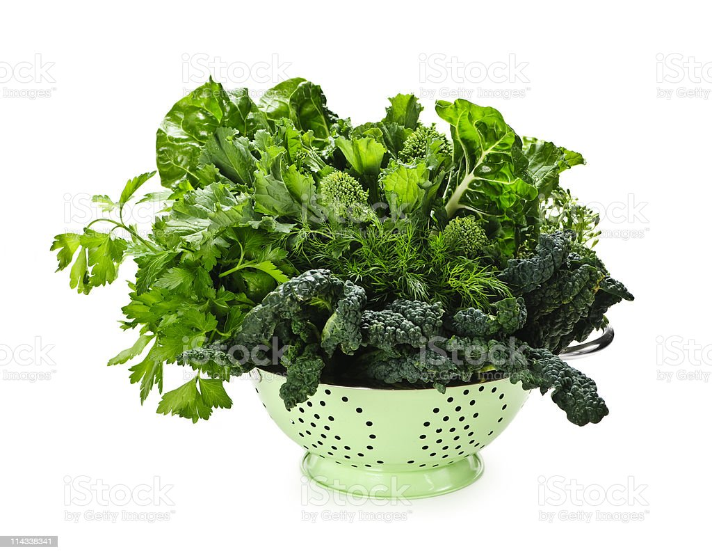 Dark green leafy vegetables in colander royalty-free stock photo