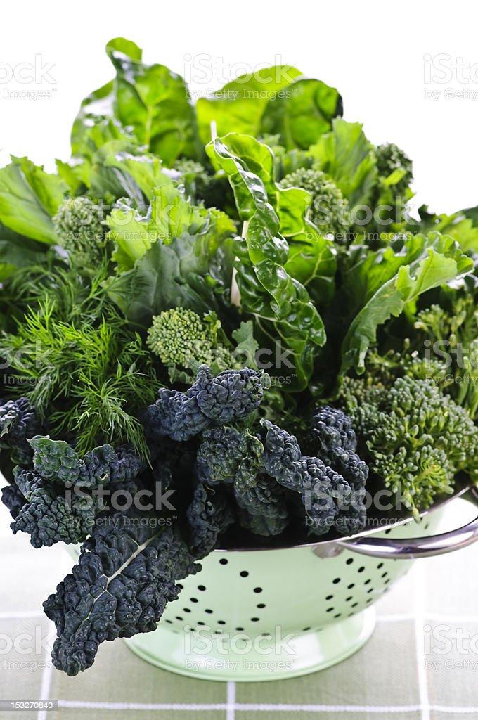 Dark green leafy vegetables in colander royalty-free stock photo