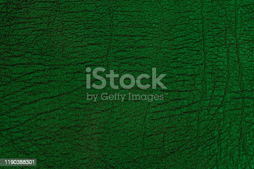 Dark green leather texture. Background and texture.
