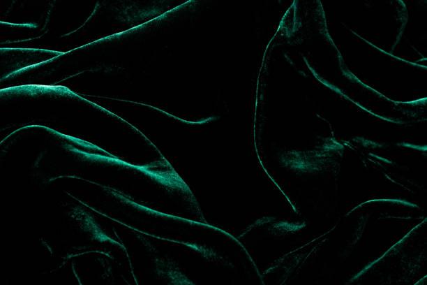 Dark green velvet background. Luxurious shiny material. stock photo