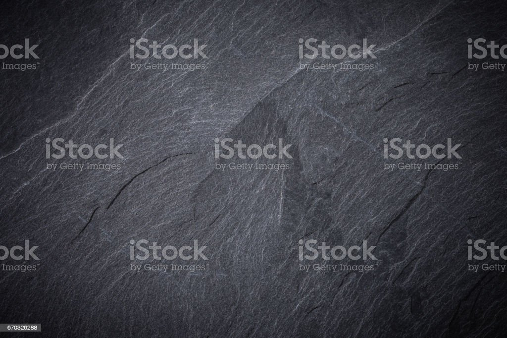 Dark grey and black slate background or texture stock photo