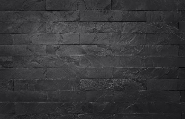 donker grijs zwart leisteen structuur in natuurlijke patroon met hoge resolutie voor achtergrond en ontwerp kunstwerk. zwarte stenen muur. - leisteen stockfoto's en -beelden