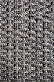 Close up dark grey rattan weave seamless pattern background.