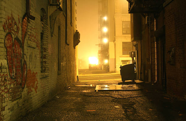 Dark Grunge Alley with Lights Shining at Night  alley stock pictures, royalty-free photos & images