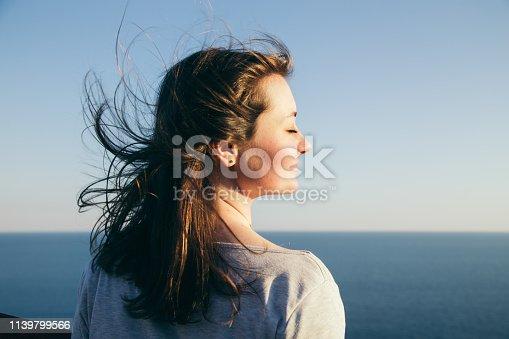 istock Dark hair girl's portrait. 1139799566