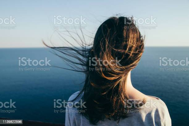 Photo of Dark hair girl's portrait.