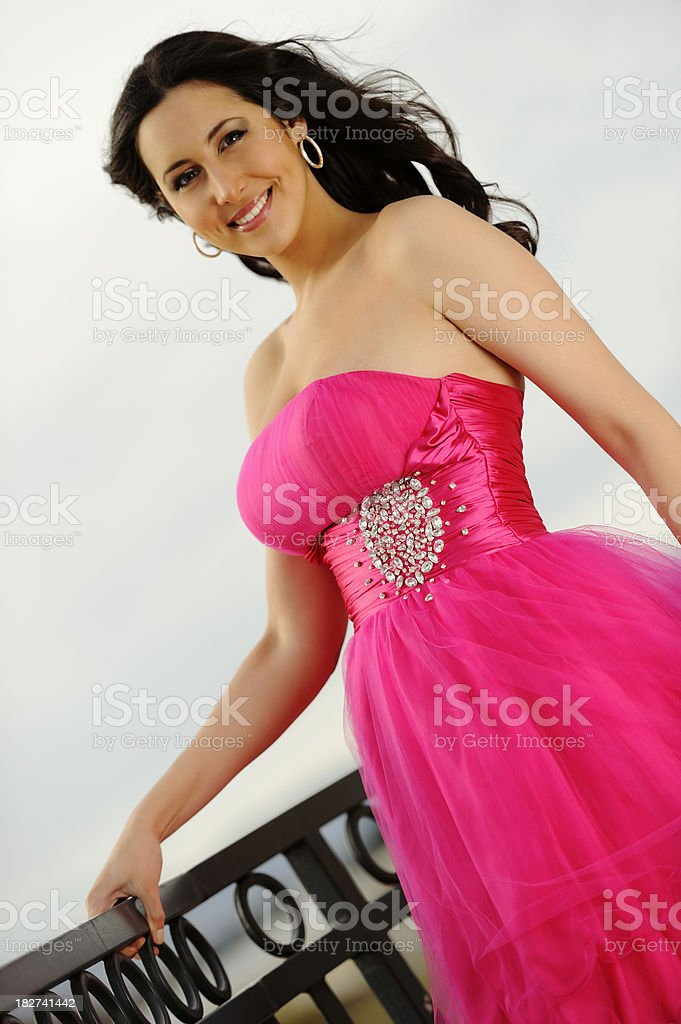 Dark Haired Beauty From Spain Poised In Hot Pink Gown royalty-free stock photo