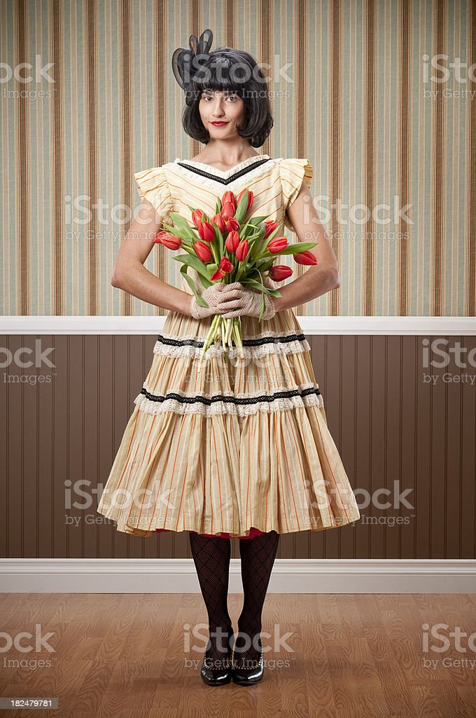 Dark Haired Woman With Tulips royalty-free stock photo