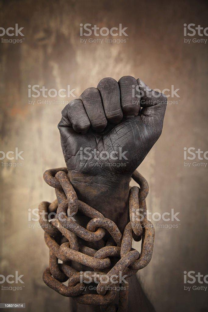 Dark Hand in Heavy Chains stock photo