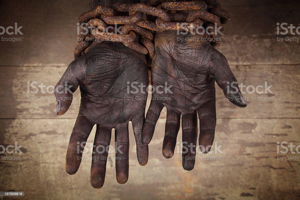 Dark Hands in Heavy Chains stock photo