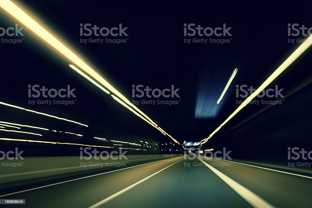 Dark highway at night, with streaks of light royalty-free stock photo
