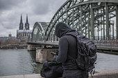 Dark hooded terrorist figure in Cologne
