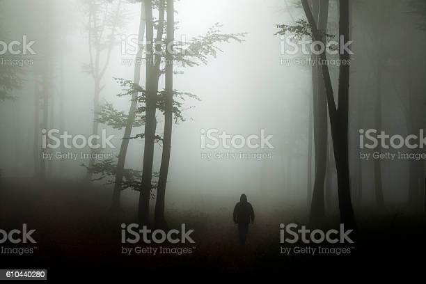 Photo of Dark horror man in creepy foggy forest