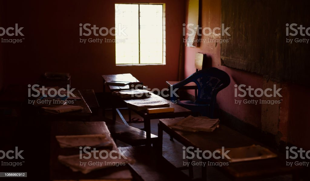 A dark interior room of a village school stock photo