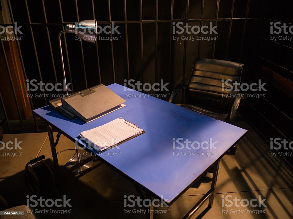Dark Interrogation Room with Chairs and Table a disturbing Situation stock photo