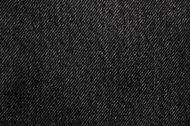 donkere jeans denim textiel macro achtergrond - zwarte spijkerbroek stockfoto's en -beelden