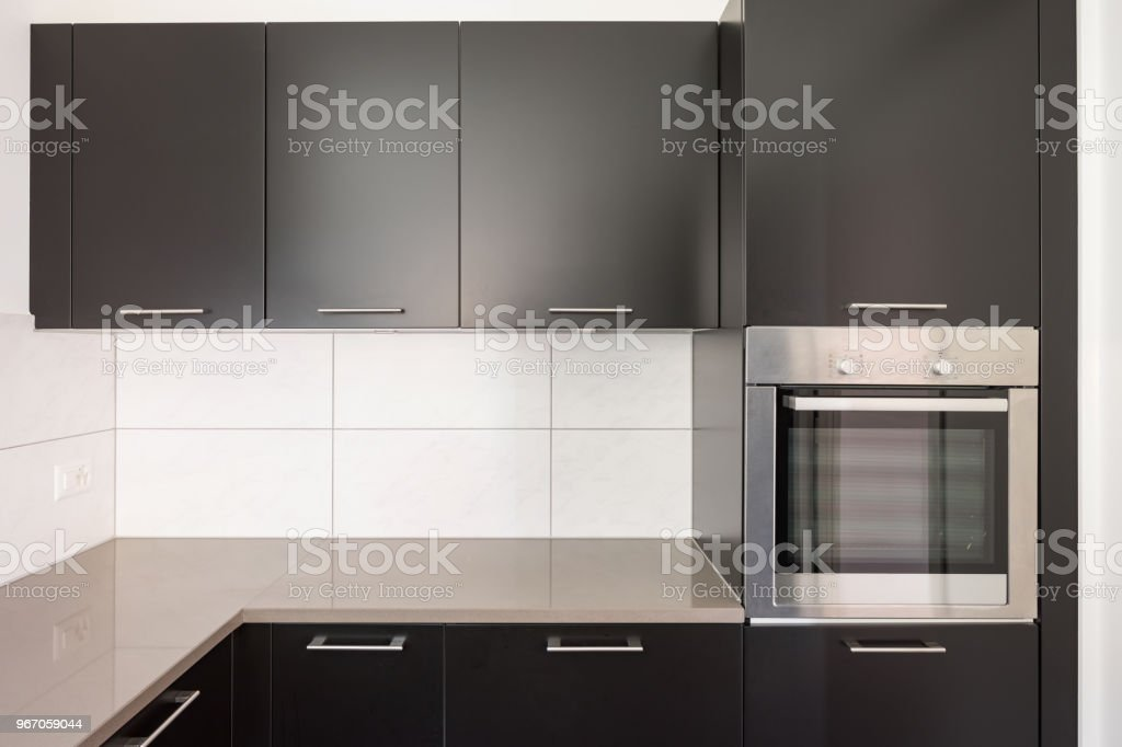 Dark Kitchen With Many Doors And White Tiles Like Parasolizzi Stock Photo Download Image Now Istock