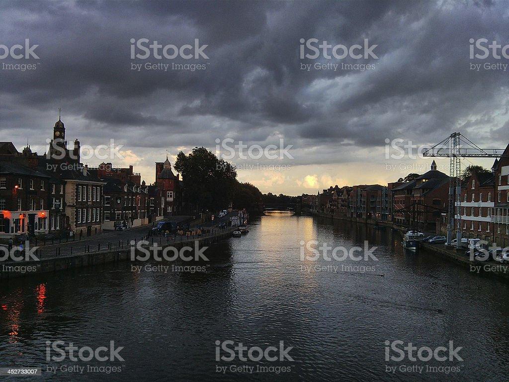 Dark landscape of river houses stock photo