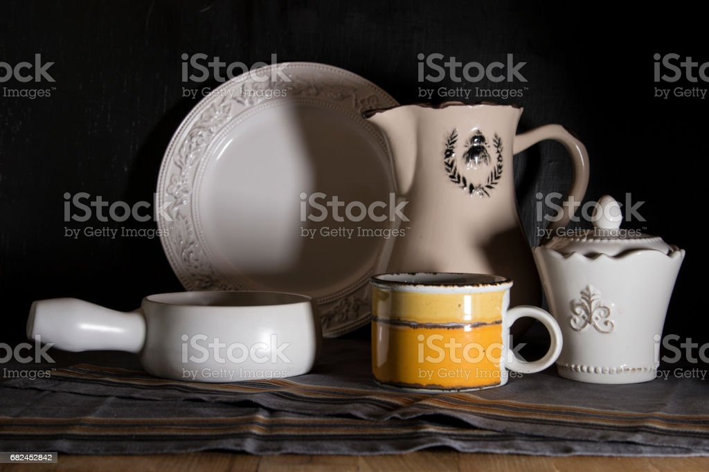 Dark light still life with country style pitcher royalty-free stock photo