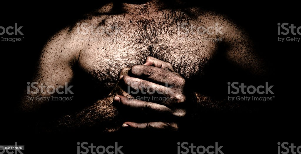 Dark Man Clasping Fist royalty-free stock photo