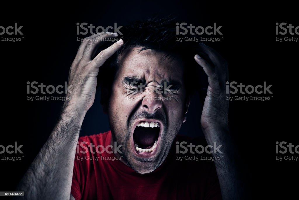 "Dark man screaming ""Dark man screaming, dark/black background."" Adult Stock Photo"