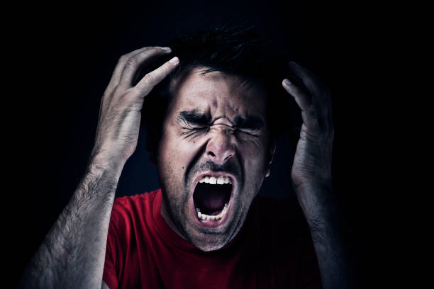Dark man screaming stock photo