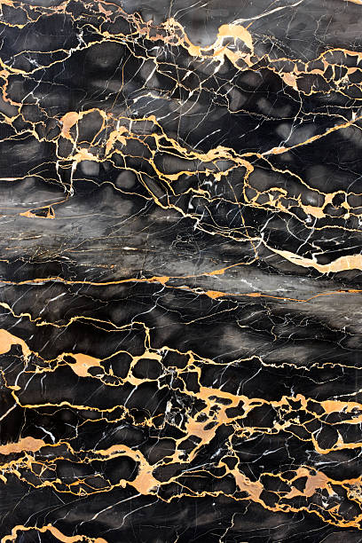 Dark marble with golden veins stock photo