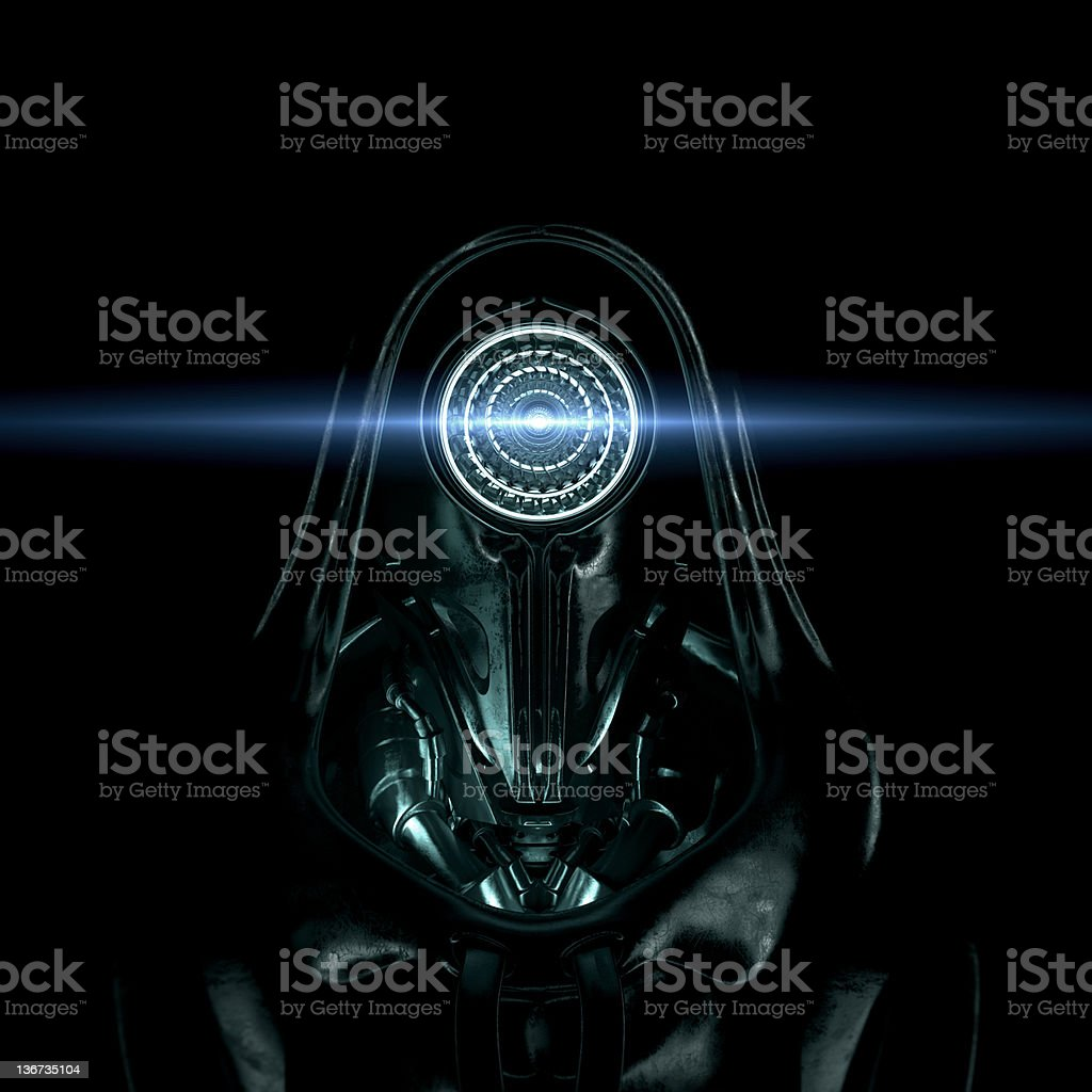 A dark menacing looking robotic figure with a blue beam stock photo