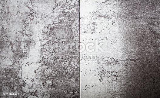 826150670istockphoto Dark metal wall 696100374