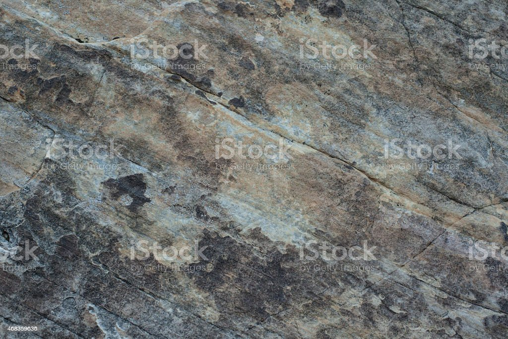 Dark mottled stone wall texture royalty-free stock photo