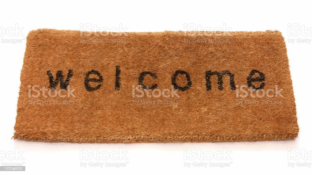 Dark mustard hued, fuzzy welcome front mat royalty-free stock photo