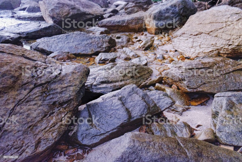 Dark night sea with protruding stones royalty-free stock photo
